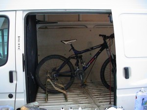 side view of bike stands in van